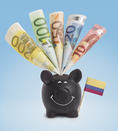 fifty euro banknote: Ten,twenty,fifty,one hundred and a 200 Euro banknote in a smiling piggybank of Colombia.(series)