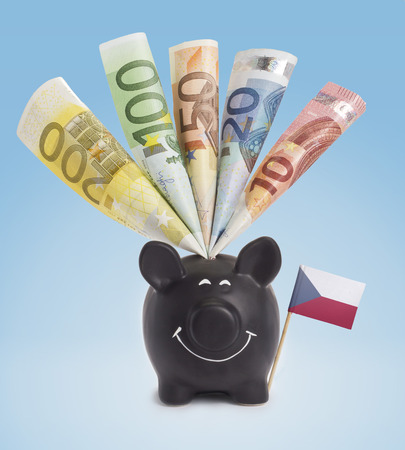 twenty euro banknote: Ten,twenty,fifty,one hundred and a 200 Euro banknote in a smiling piggybank of Czech Republic.(series) Stock Photo