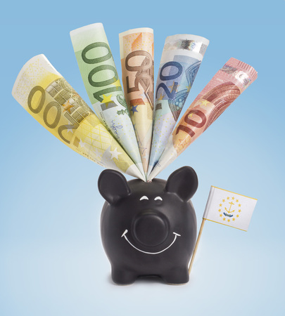 twenty euro banknote: Ten,twenty,fifty,one hundred and a 200 Euro banknote in a smiling piggybank of Rhode Island.(series) Stock Photo