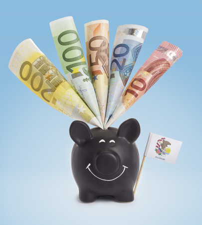 twenty euro banknote: Ten,twenty,fifty,one hundred and a 200 Euro banknote in a smiling piggybank of Illinois.(series)