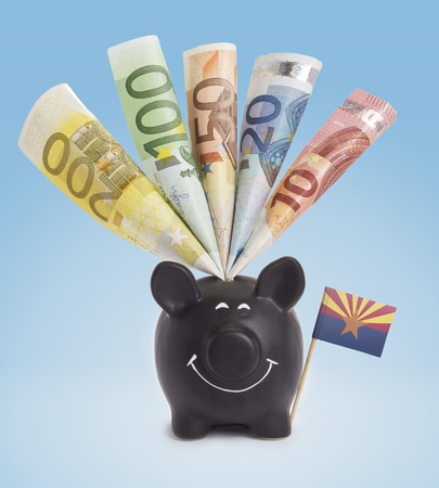 twenty euro banknote: Ten,twenty,fifty,one hundred and a 200 Euro banknote in a smiling piggybank of Arizona.(series)
