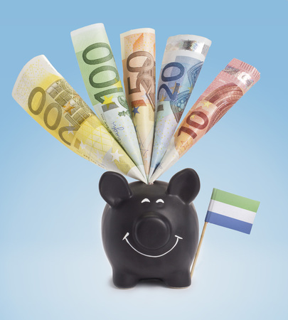 twenty euro banknote: Ten,twenty,fifty,one hundred and a 200 Euro banknote in a smiling piggybank of Sierra Leone.(series)