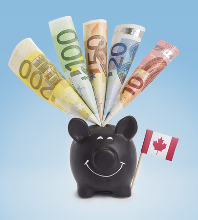 one hundred euro banknote: Ten,twenty,fifty,one hundred and a 200 Euro banknote in a smiling piggybank of Canada.(series)