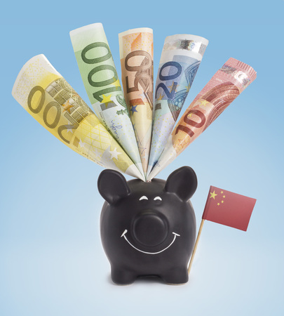twenty euro banknote: Ten,twenty,fifty,one hundred and a 200 Euro banknote in a smiling piggybank of China.(series) Stock Photo