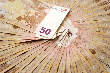 number 50: Several 50 euro banknotes fanned with the number 50 in the centre Stock Photo