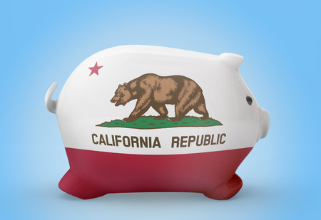 tax evasion: Side view of a piggy bank with the flag design of California.(series)