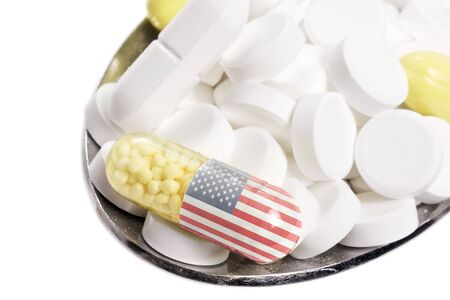 The national flag of USA on a capsule and pills on a spoon.(series) Stock Photo