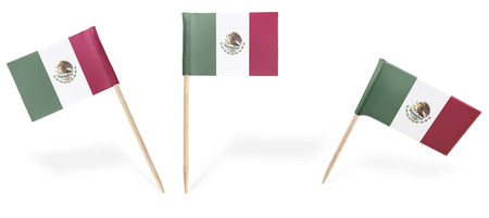 Small cocktail flags of Mexico in different positions isolated on white.(series) . Also easy to use as a design element :)