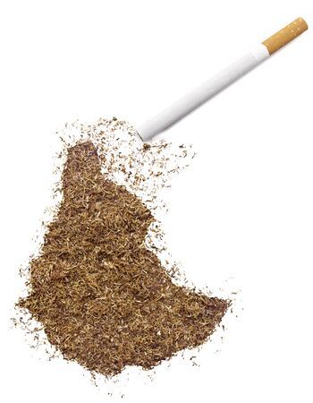 ethiopia abstract: The country shape of Ethiopia made of tobacco and a cigarette.(series) Stock Photo
