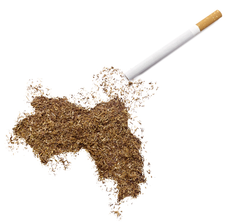 ciggy: The country shape of Guinea made of tobacco and a cigarette.(series) Stock Photo