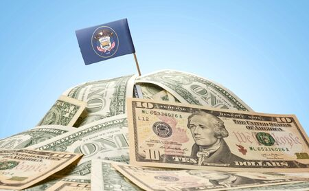 The national flag of Utah sticking in a pile of american dollars.(series)