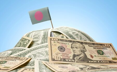 national flag bangladesh: The national flag of Bangladesh sticking in a pile of american dollars