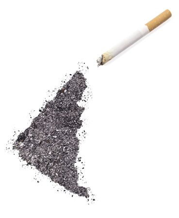 ciggy: The country shape of Yukon made of tobacco ash and a cigarette.(series)