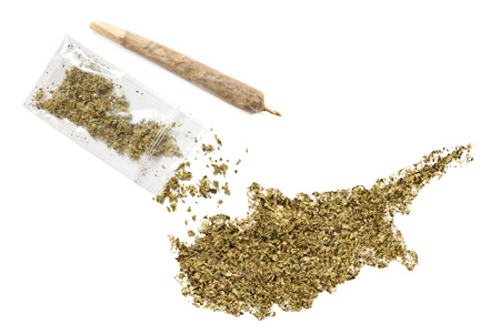 middle joint: Grinded weed shaped as Cyprus and a joint.(series) Stock Photo