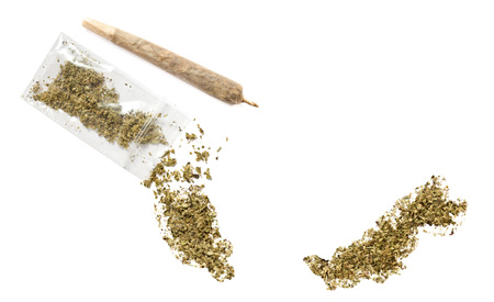 grinded: Grinded weed shaped as Malaysia and a joint.(series) Stock Photo