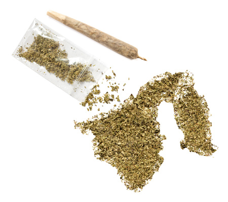 grinded: Grinded weed shaped as Brunei and a joint.(series) Stock Photo