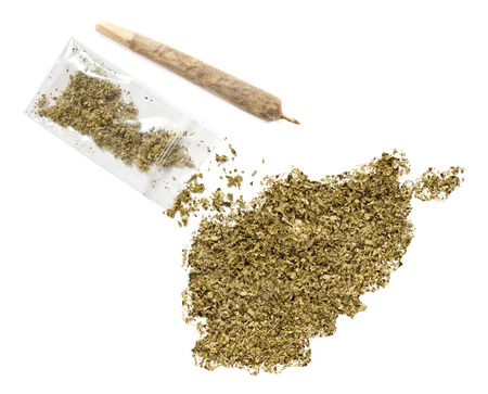 grinded: Grinded weed shaped as Afghanistan and a joint.(series) Stock Photo