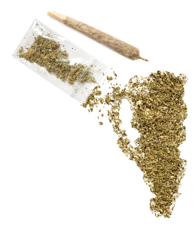 grinded: Grinded weed shaped as Gibraltar and a joint.(series) Stock Photo