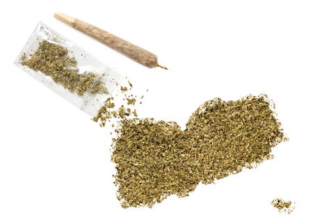 middle joint: Grinded weed shaped as Yemen and a joint.(series) Stock Photo