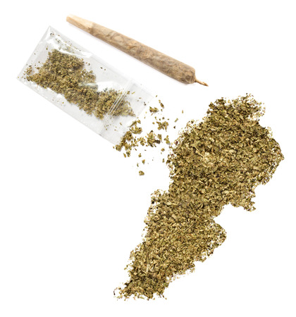 middle joint: Grinded weed shaped as Lebanon and a joint.(series) Stock Photo