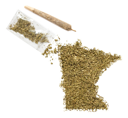 grinded: Grinded weed shaped as Minnesota and a joint.(series) Stock Photo
