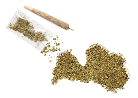 grinded: Grinded weed shaped as Latvia and a joint.(series) Stock Photo