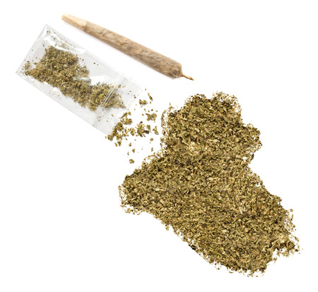middle joint: Grinded weed shaped as Iraq and a joint.(series) Stock Photo