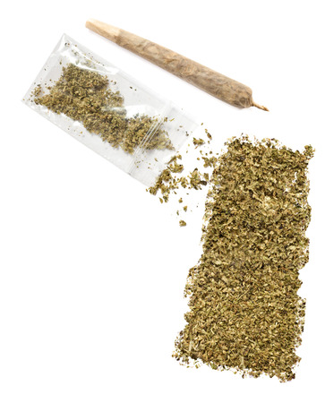 saskatchewan: Grinded weed shaped as Saskatchewan and a joint.(series) Stock Photo