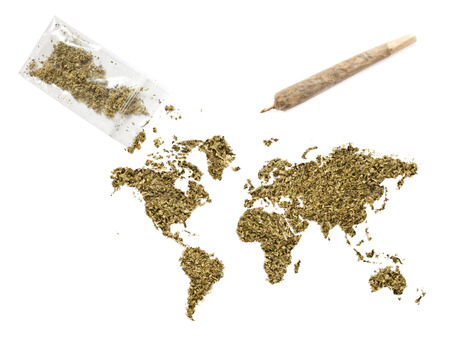 Grinded weed shaped as the world and a joint.(series) Stock Photo