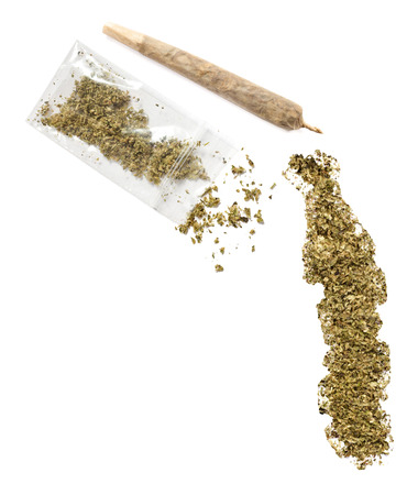 grinded: Grinded weed shaped as Togo and a joint.(series) Stock Photo