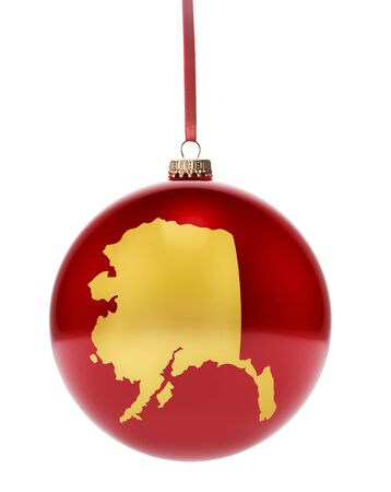 alaskan: A hanging glossy red bauble with the golden shape of Alaska.(series) Stock Photo