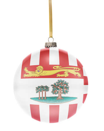 edward: A glossy christmas ball in the national colors of Prince Edward Island hanging on a golden string isolated on a white background.(series) Stock Photo