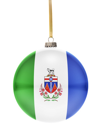 yukon: A glossy christmas ball in the national colors of Yukon hanging on a golden string isolated on a white background.(series)