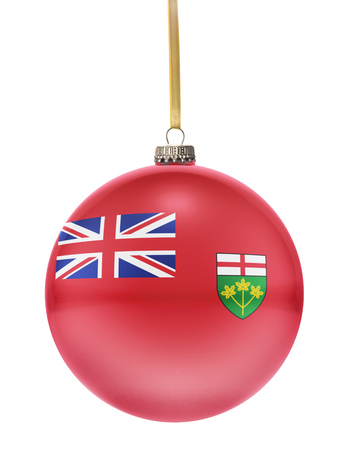 ontario: A glossy christmas ball in the national colors of Ontario hanging on a golden string isolated on a white background.(series) Stock Photo