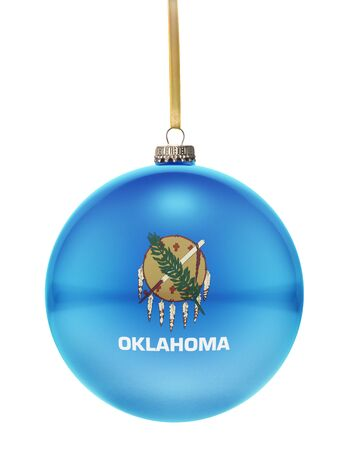 A glossy christmas ball in the national colors of Oklahoma hanging on a golden string isolated on a white background.(series)