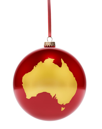 glass christmas tree ornament: A hanging glossy red bauble with the golden shape of Australia.(series) Stock Photo