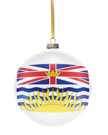 british columbia: A glossy christmas ball in the national colors of British Columbia hanging on a golden string isolated on a white background.(series)