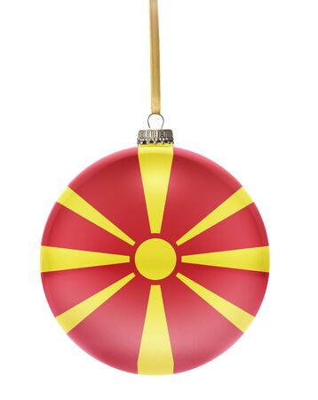 national colors: A glossy christmas ball in the national colors of Macedonia hanging on a golden string isolated on a white background.(series) Stock Photo