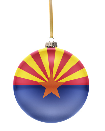 A glossy christmas ball in the national colors of Arizona hanging on a golden string isolated on a white background.(series) Banque d'images
