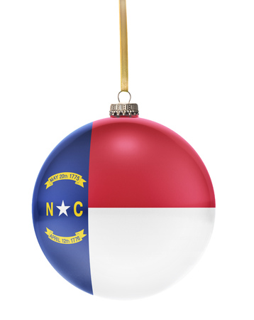 hanging string: A glossy christmas ball in the national colors of North Carolina hanging on a golden string isolated on a white background.(series)