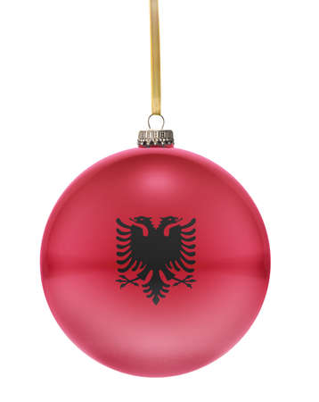 national colors: A glossy christmas ball in the national colors of Albania hanging on a golden string isolated on a white background.(series) Stock Photo
