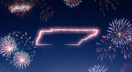 A dark night sky with a sparkling red firecracker in the shape of Tennessee composed into.(series)