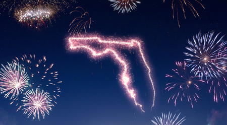 A dark night sky with a sparkling red firecracker in the shape of Florida composed into.(series)