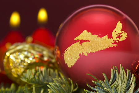 A glossy red bauble with the golden shape of Nova Scotia.(series)