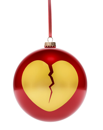 A hanging glossy red bauble with the golden shape of a broken heart.(series)