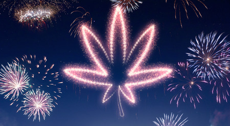 A dark night sky with a sparkling red firecracker in the shape of a weed leaf composed into.(series) Stock Photo