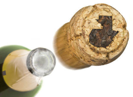 Champagne cork with the shape of Guatemala burnt in and bottle of champagne in the back.(series)