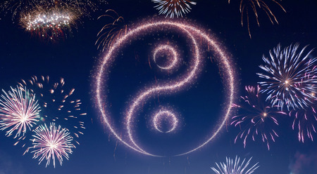 A dark night sky with a sparkling red firecracker in the shape of a Ying Yang symbol composed into.(series)