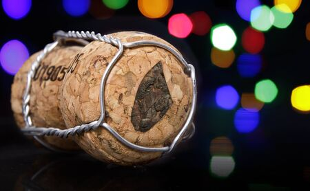 Champagne cork with the shape of Djibouti burnt in and colorful blurry lights in the background.(series) Stock Photo