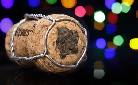 Champagne cork with the shape of Ivory Coast burnt in and colorful blurry lights in the background.(series) Stock Photo